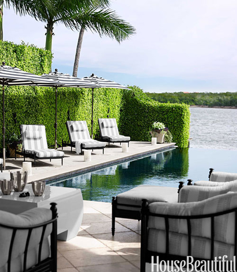 Monochromatic Gray Home in Naples, Florida: Poolside Chairs